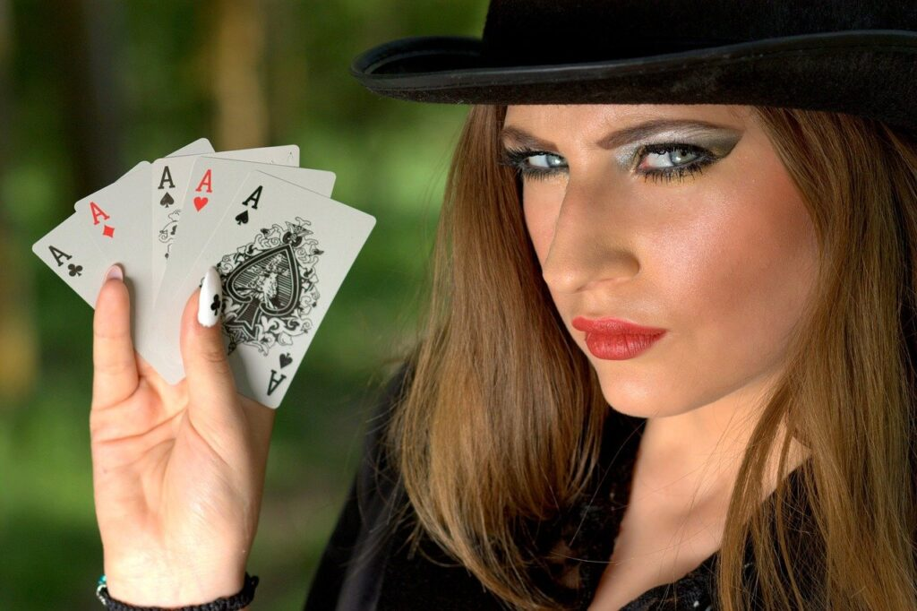 Poker cards hold by a lady